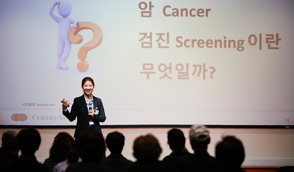 Dong Hee Kim, Community Outreach coordinator at the Research Center for Health Equity, conducting a cancer awareness workshop with community members at Los Angeles Onnuri Church in Koreatown. (2018)