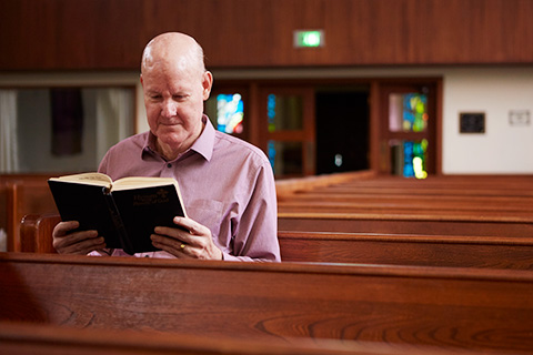 Scott erdman reading bible in church