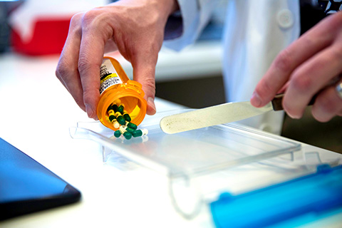 Medical Technician examining pills